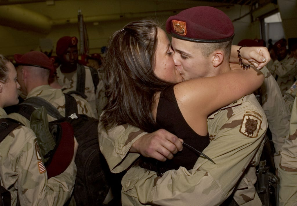 Jennifer Chapman embraces her husband, Dustin Chapman, with a kiss upon his return from Iraq on Nov. 9, 2005, in Fort Bragg, NC.