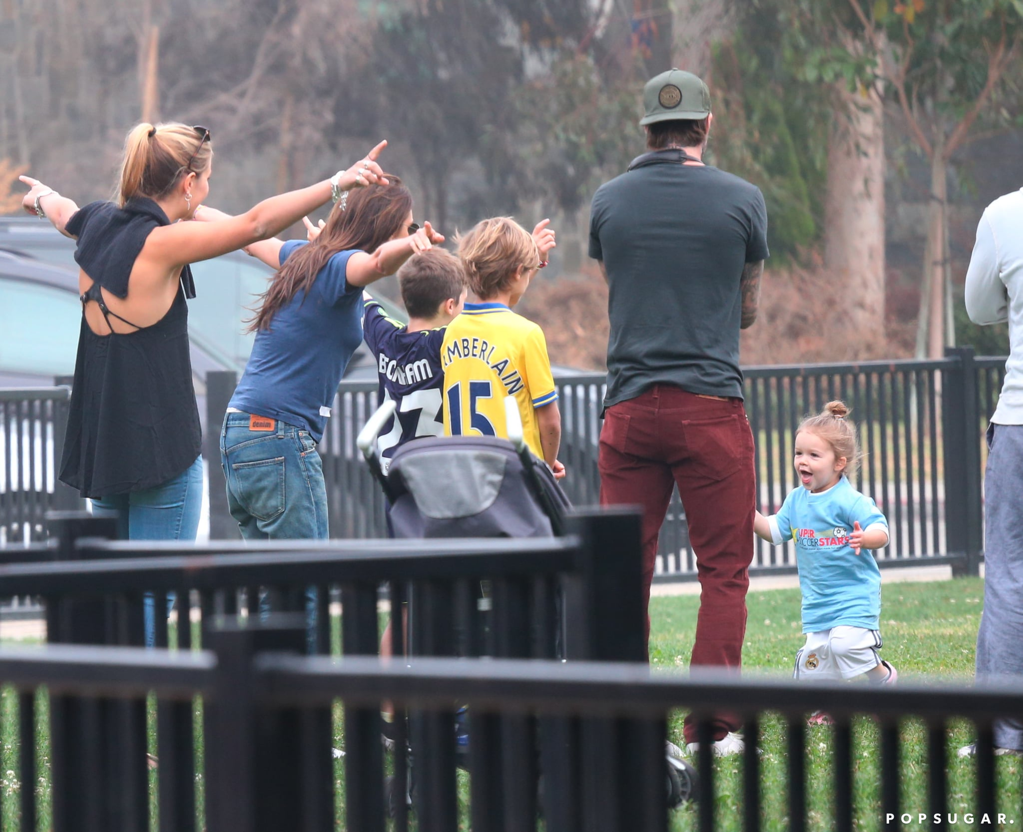 The Beckhams took to the soccer field to watch Harper play.