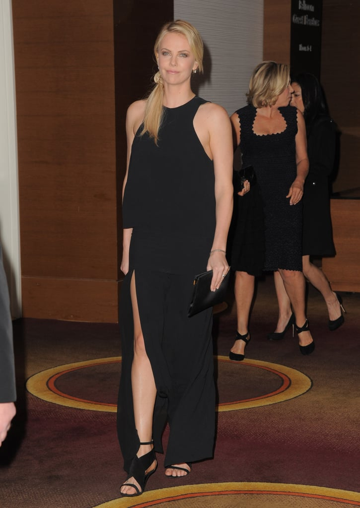 Looks like Charlize is a fan of the thigh-high slit, too, as seen in this long Acne dress.