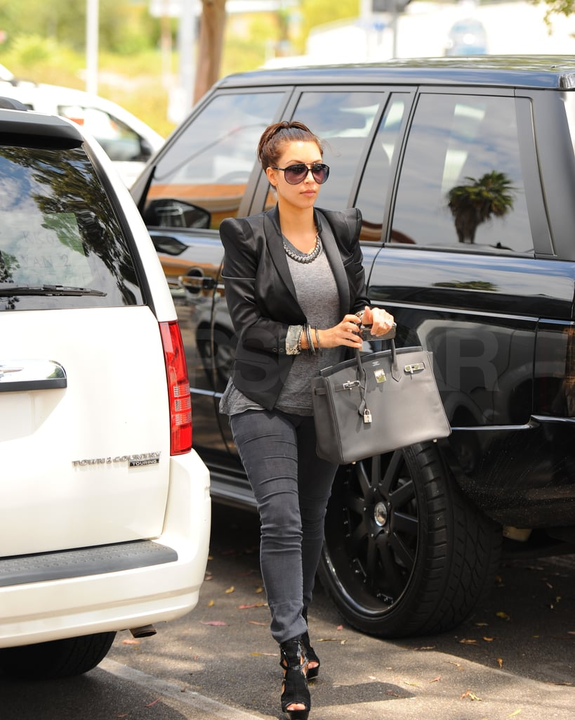 Kim Kardashian changed into shades of gray for a meeting.