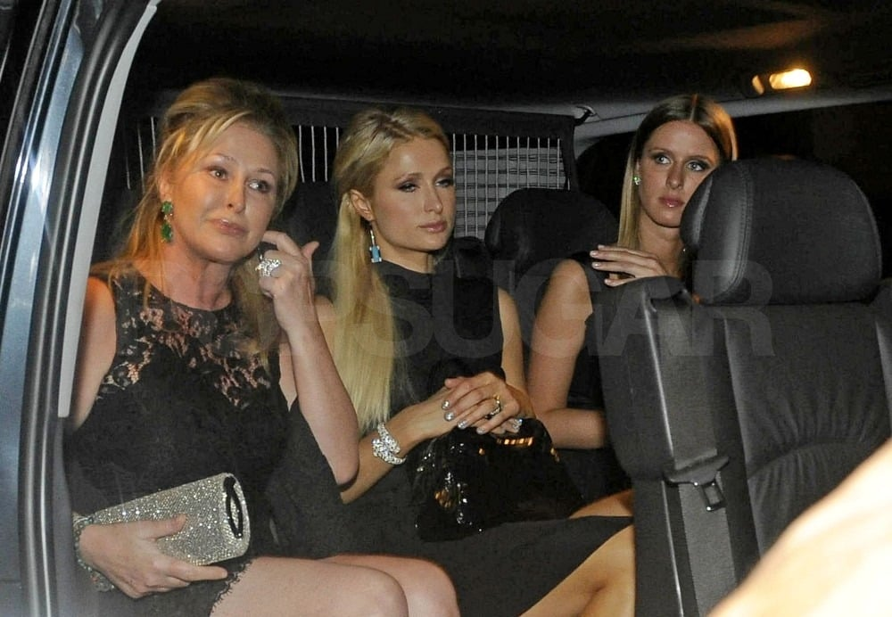 Kathy, Paris, and Nicky Hilton piled into the back of an SUV.