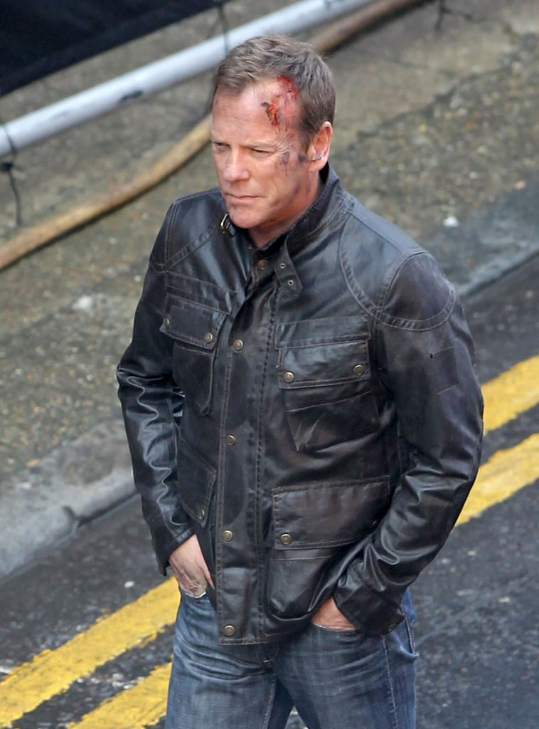 Ever the tough guy, Kiefer Sutherland sported some serious cuts as he channeled Jack Bauer on the set of 24: Live Another Day in London on Wednesday.