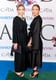 Twinning combo: At the 2014 CFDA awards, the duo covered up in demure dresses.   Ashley added pearls for an extra hint of sophistication. Mary-Kate kept her outfit from looking dowdy by adding sexy lace-up stilettos.