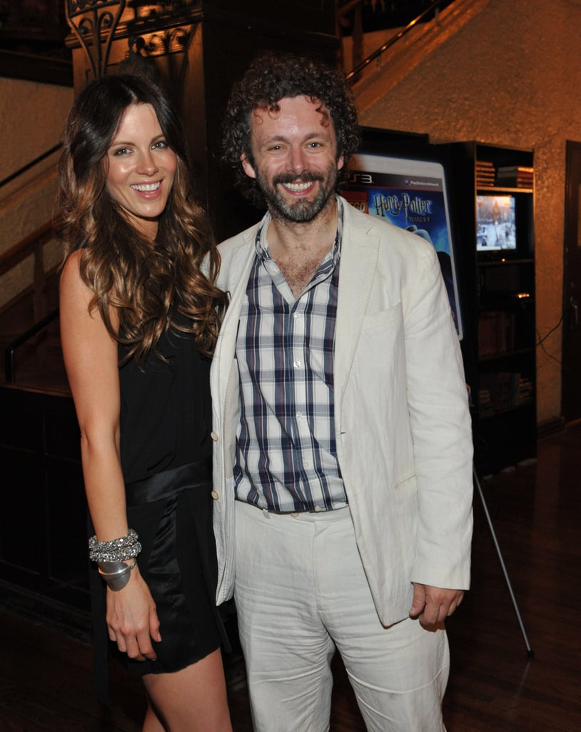 Michael Sheen and Kate Beckinsale smile for a picture.