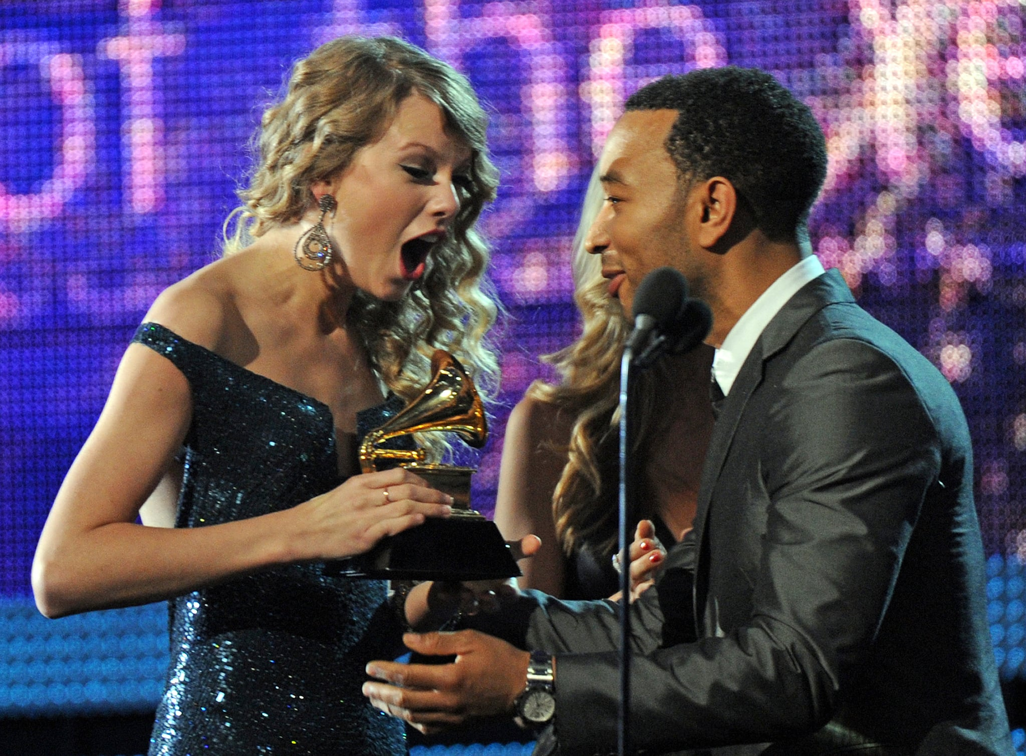 Taylor was thrilled to be presented with the album of the year award by John Legend at the Grammys in January 2010.
