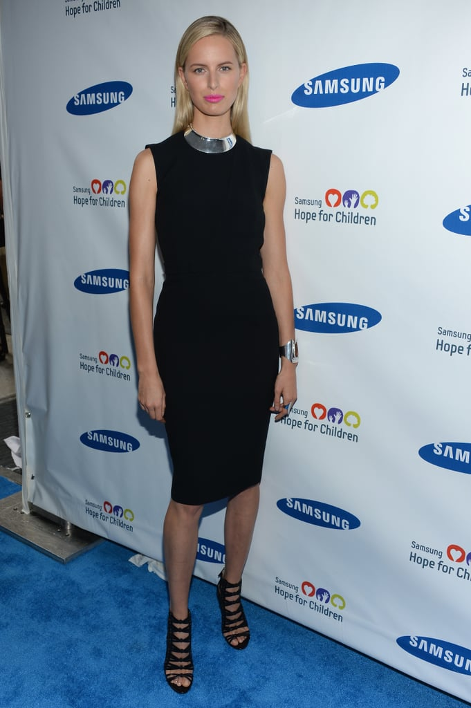 Karolina Kurkova chose a silver collar necklace and matching cuff to amp up her little black dress and caged sandals at a Samsung event in NYC.