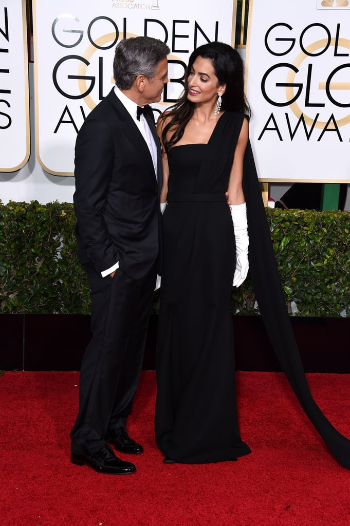 It was like the cameras weren't even there when George and Amal walked the red carpet at the 2015 Golden Globes in January.