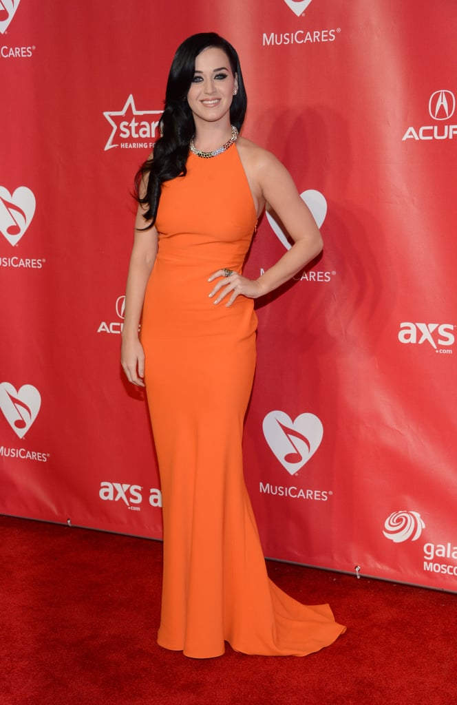 The brunette was an absolute vision in this form-fitting tangerine halter from Alexander McQueen's Resort 2013 collection at the MusiCares gala in February 2013.