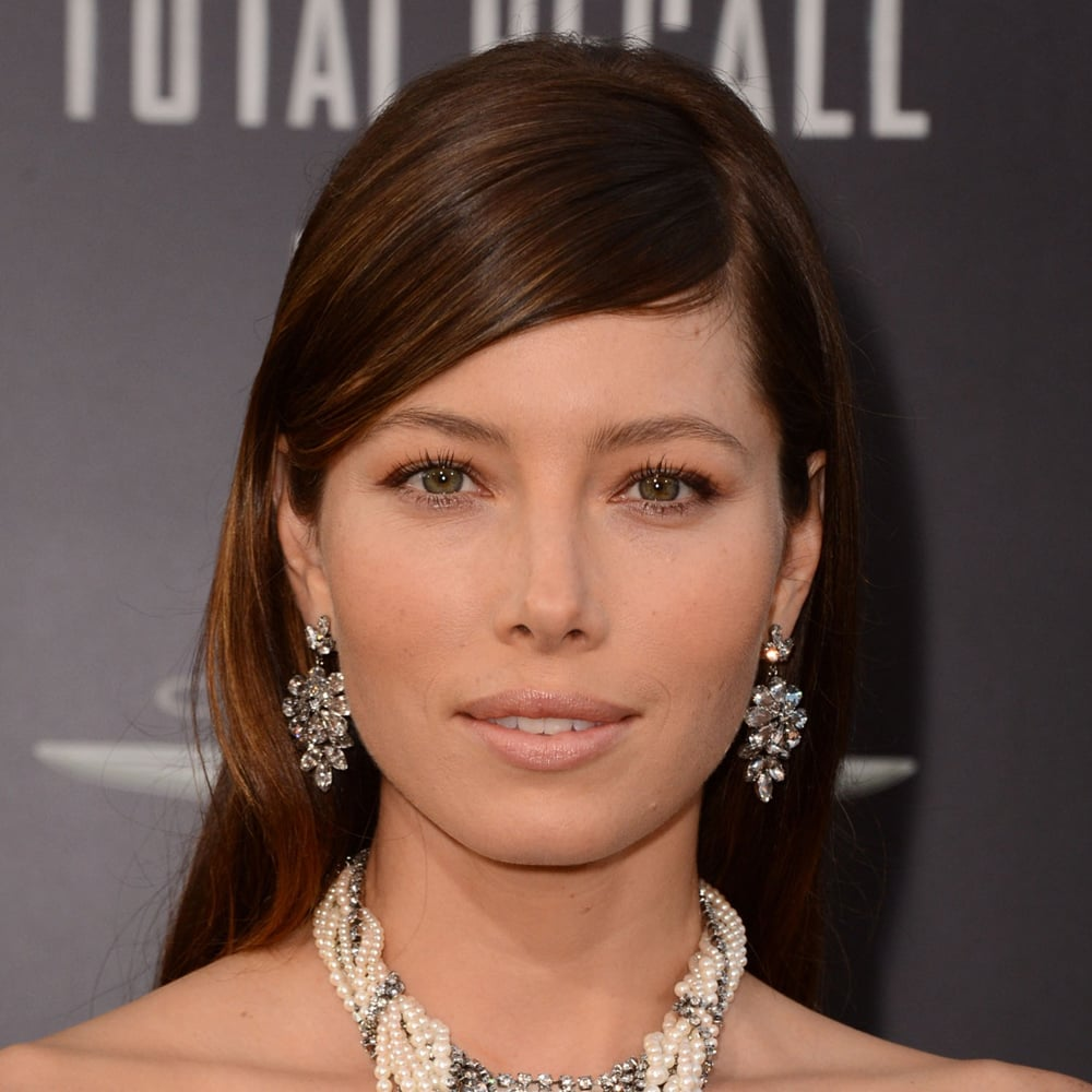Jessica Biel wore her thick fringe parted to one side at the Hollywood premiere of Total Recall. We think it's a really soft and feminine look for the star. After combing across, use a matte hairspray like Moroccan Oil Luminous Hairspray Strong Flexible Hold ($34.95) — it will hold the hair in place but won't make it look like cardboard!