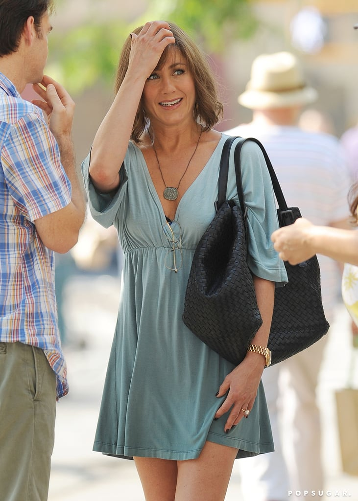 On July 17, Jennifer Aniston donned a wig on the set of her new project, Squirrels to the Nuts.