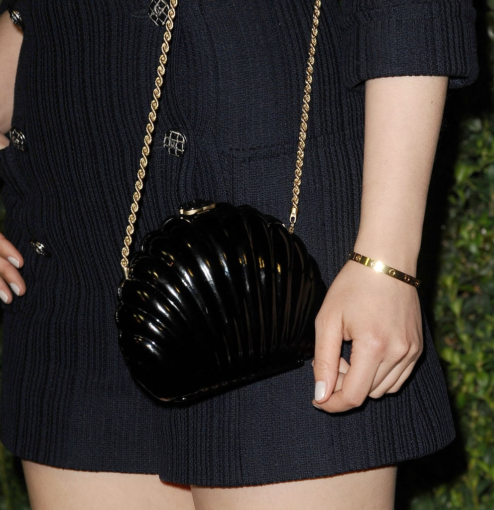 Her shell-shaped Chanel purse kept the feel of Ginnifer's nautical look intact.