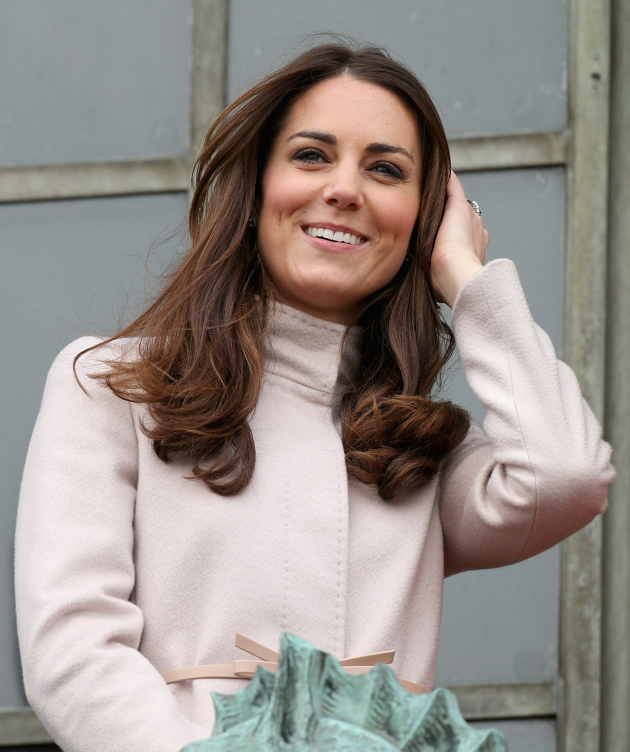 Kate Middleton wore a camel-colored jacket in Cambridge.