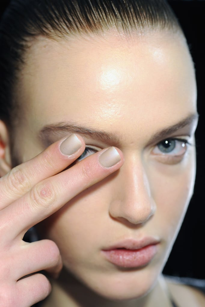 Wang took his androgynous favoritism to another level, asking CND lead artist Jan Arnold to create a unisex nail. The sandstone-inspired art was created by criss-crossing a fan brush up the nail before slapping down a speedy top coat. Artists then buffed away the shine of the top coat to add to the weathered, stone-like look.