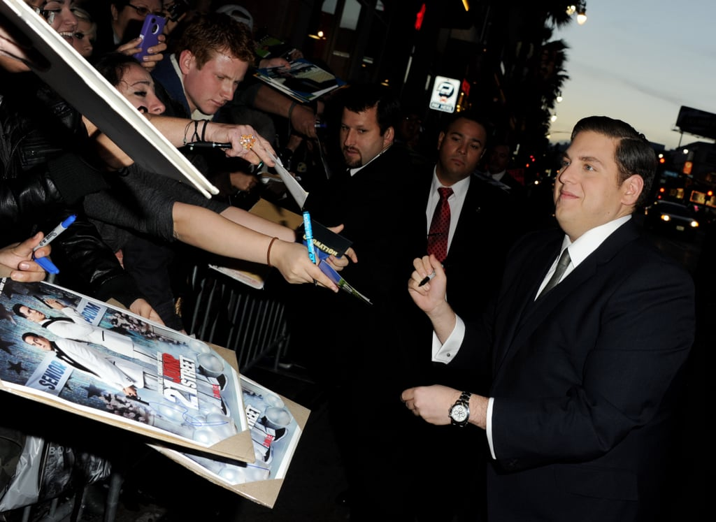 Jonah Hill signed autographs across the street.