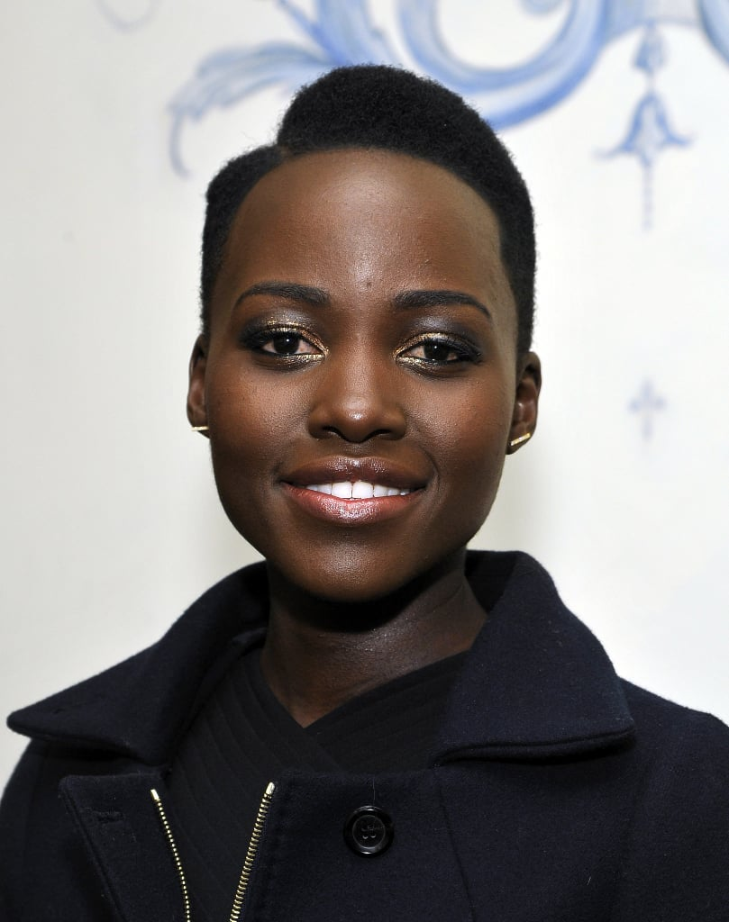 We couldn't help but be reminded of the guys from Kid and Play and the House Party movies when we saw Lupita's hair at the W Magazine party ahead of the Golden Globes! Her gold and gunmetal eyeshadow made her palette twice as nice.