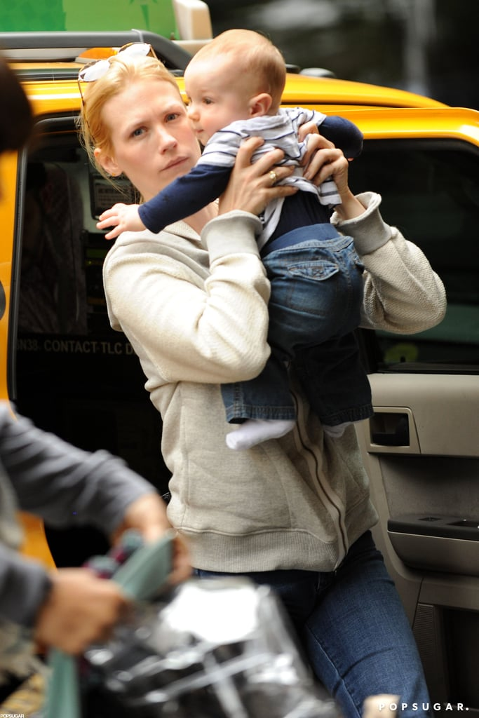 January Jones picked up Xander while getting out of a cab in NYC.