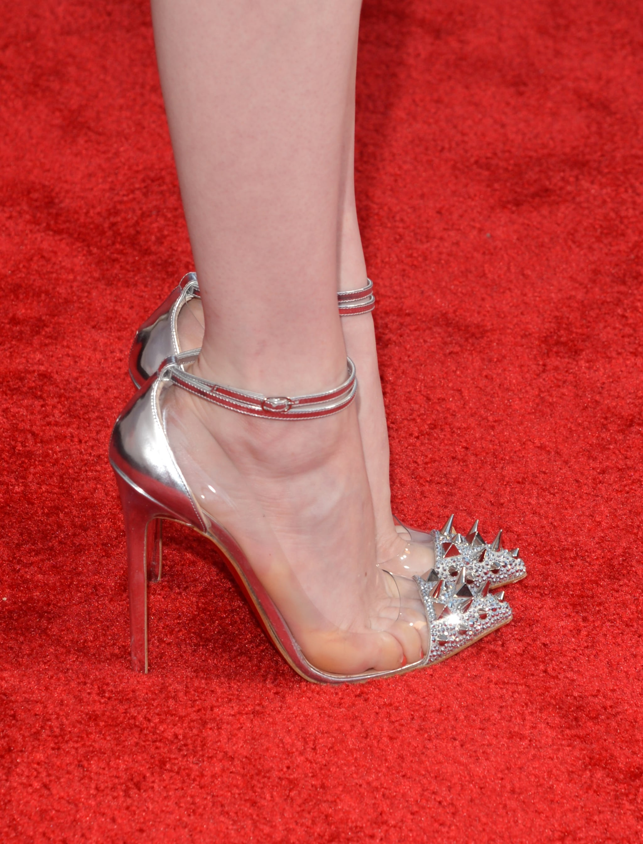 fake red bottom heels - The metallic sheen and spiked cap-toes on Emma's Louboutin pumps ...
