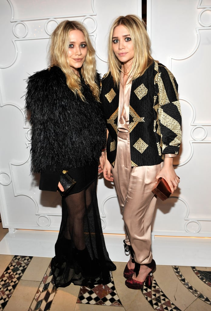 Twinning combo: Once again proving it's all about a statement coat at amfAR's Fall 2010 Fashion Week kickoff party.  Mary-Kate upped the intrigue by layering a full-feathered jacket over her sheer-overlay dress. Ashley topped her silk champagne separates with a black-and-gold geometric-print jacket.