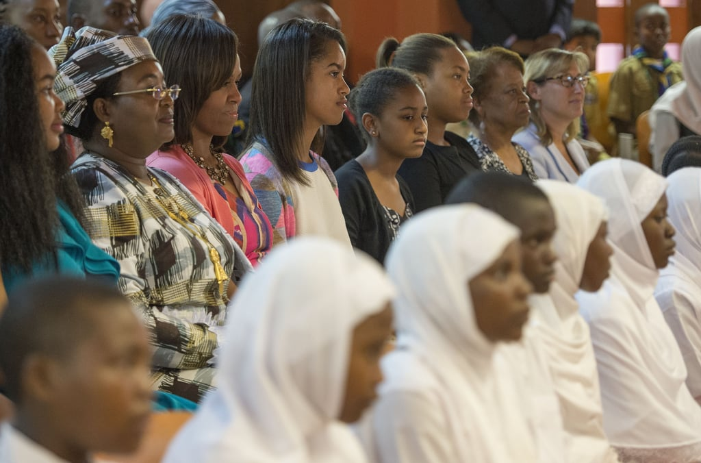 Michelle, Malia, and Sasha Obama attended a dance performance in Dar es Salaam, Tanzania, in July 2013.