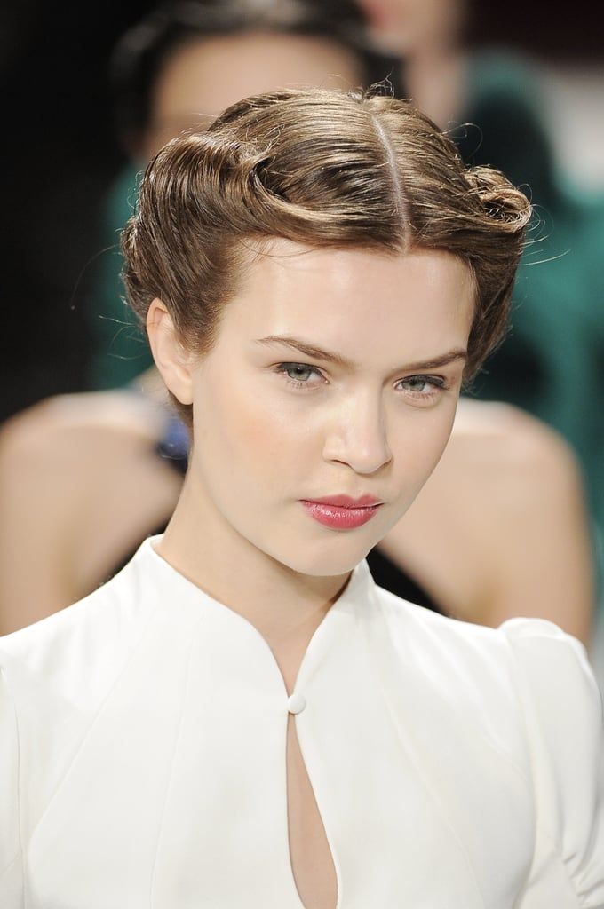 A chic '40s-style rolled updo kept the hair off the face of models in the Carolina Herrera Fall 2013 show.