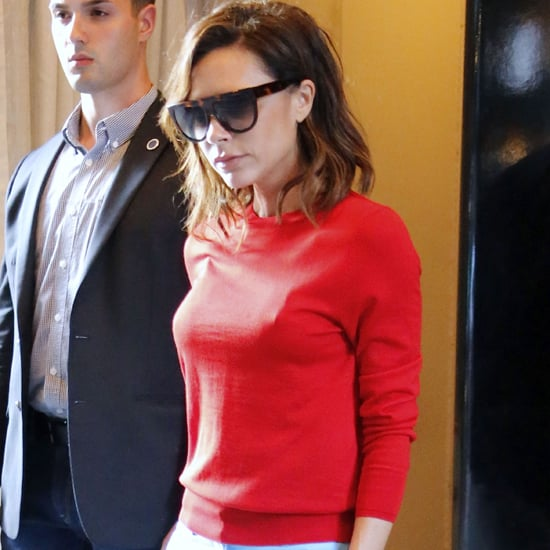 Victoria Beckham Wearing Red Top and Blue Pants June 2016