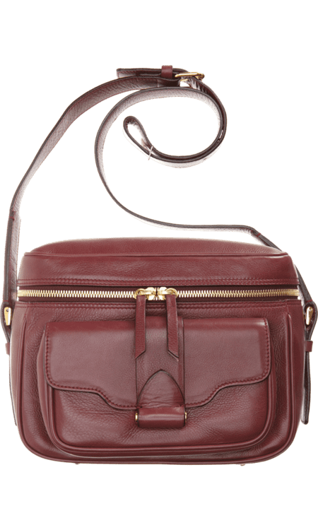 """""""Garance Doré I am not, but I can play the part with Derek Lam's awesome iteration of the camera bag. The compact size is ideal for running around, but the width makes it so easy to pack a lot of (small) things in."""" — Noria Morales, style director Derek Lam Newton Camera Bag ($1,390)"""