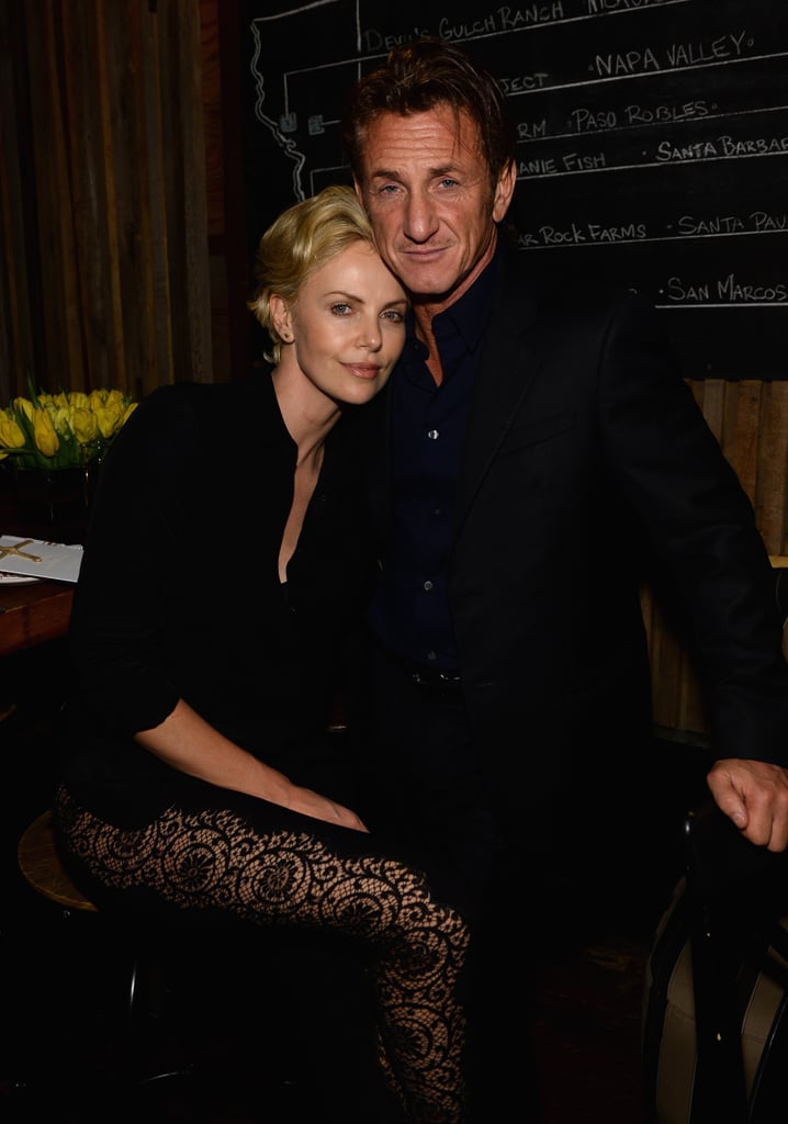 Charlize Theron cuddled up to Sean Penn at Pharrell Williams's pre-Oscars bash.