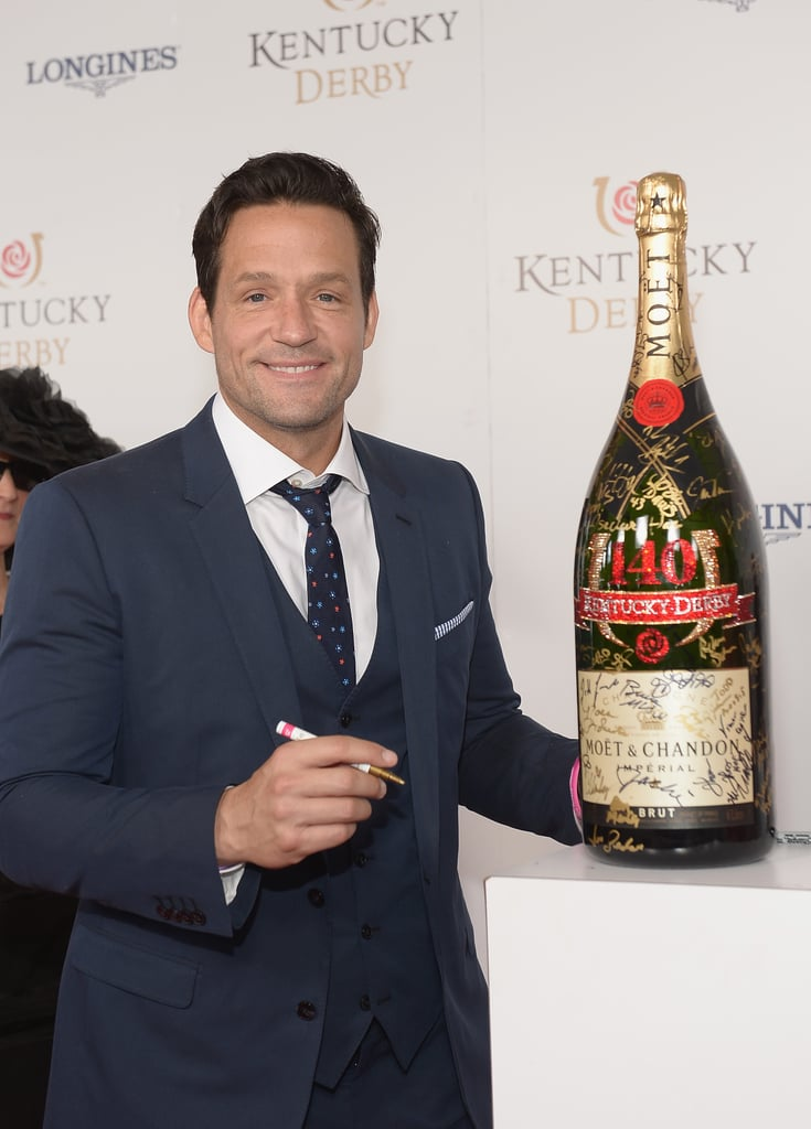 Josh Hopkins signed the bottle of Champagne on the red carpet.