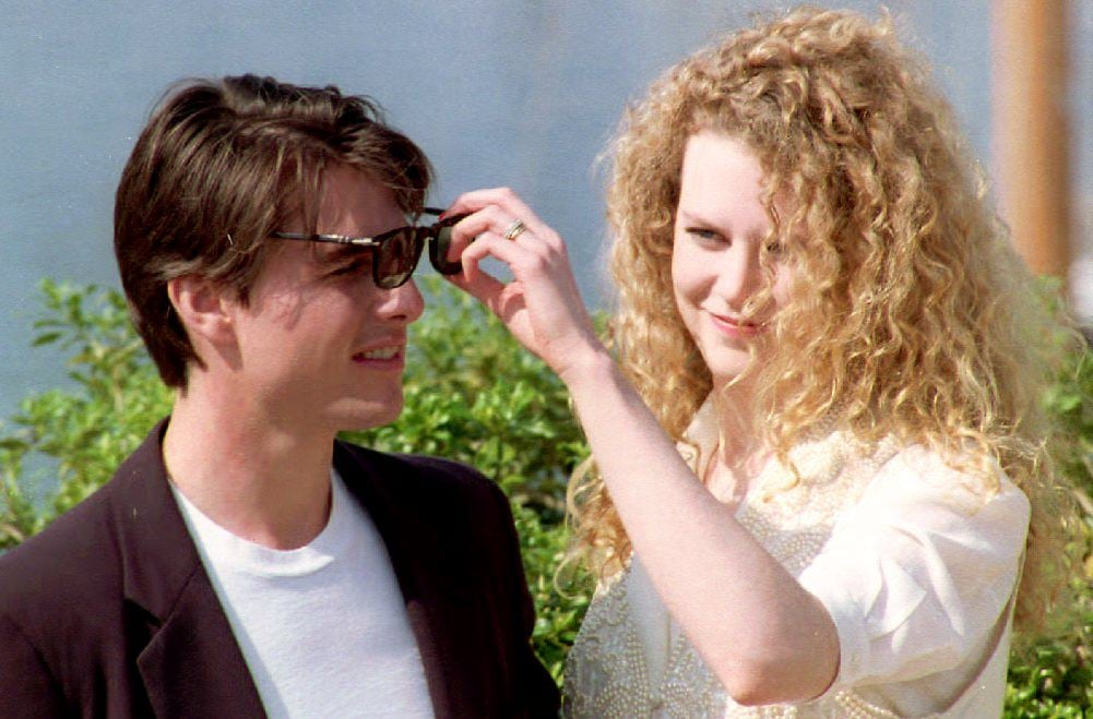 Nicole Kidman playfully adjusted then-husband Tom Cruise's sunglasses in 1992.
