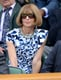 Anna Wintour popped in the bleachers of Wimbledon in her blue printed dress and colorful jeweled necklace.