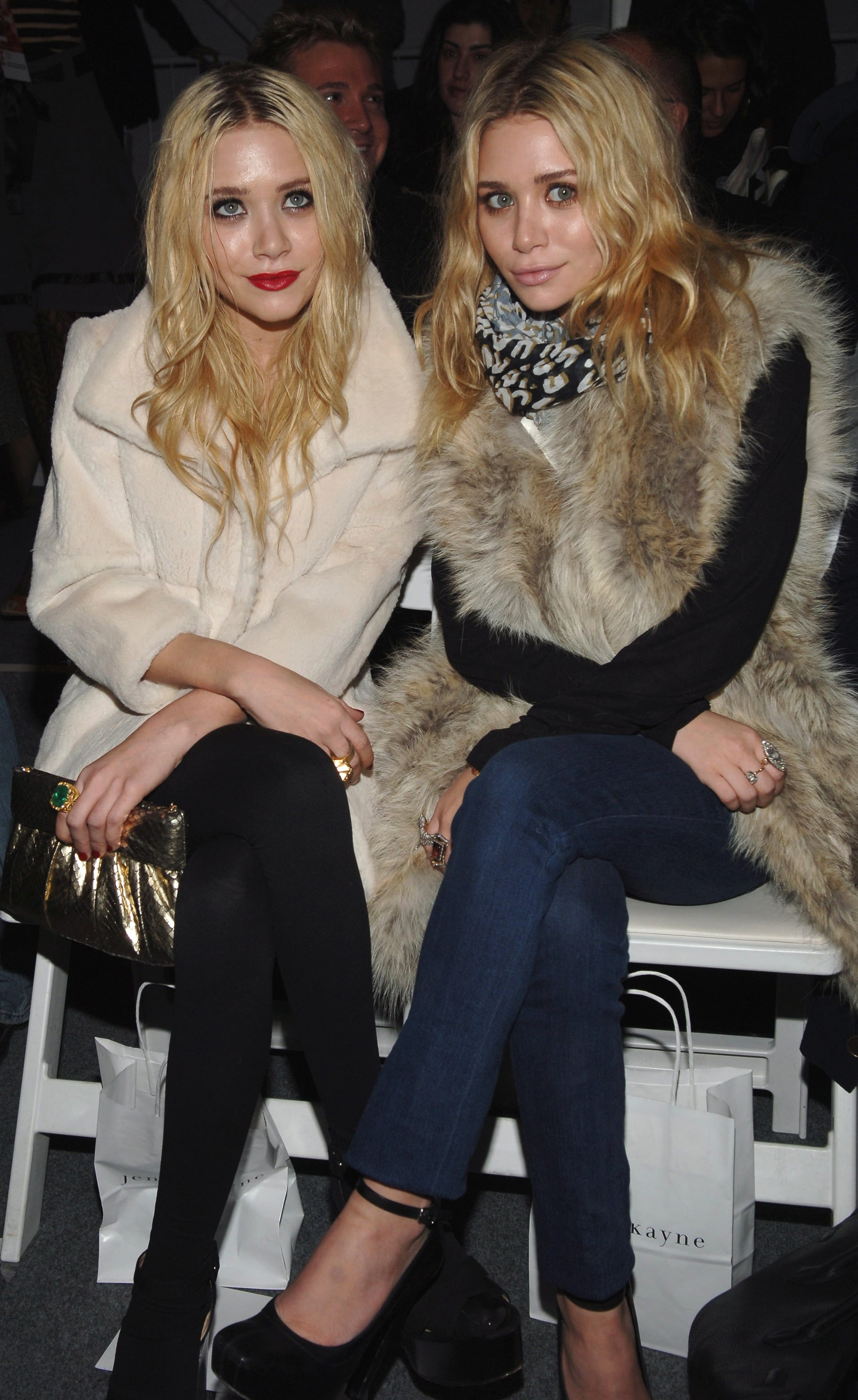 Twinning combo: The girls sat front row at the Jenni Kayne Fall 2007 show donning plush fur outerwear.  Mary-Kate styled her rich cream-colored coat with black leggings and chunky ankle boots.  Ashley showed her support for Jenni Kayne donning a lavish fur vest from her collection with true-blue denim and ankle-strap pumps.