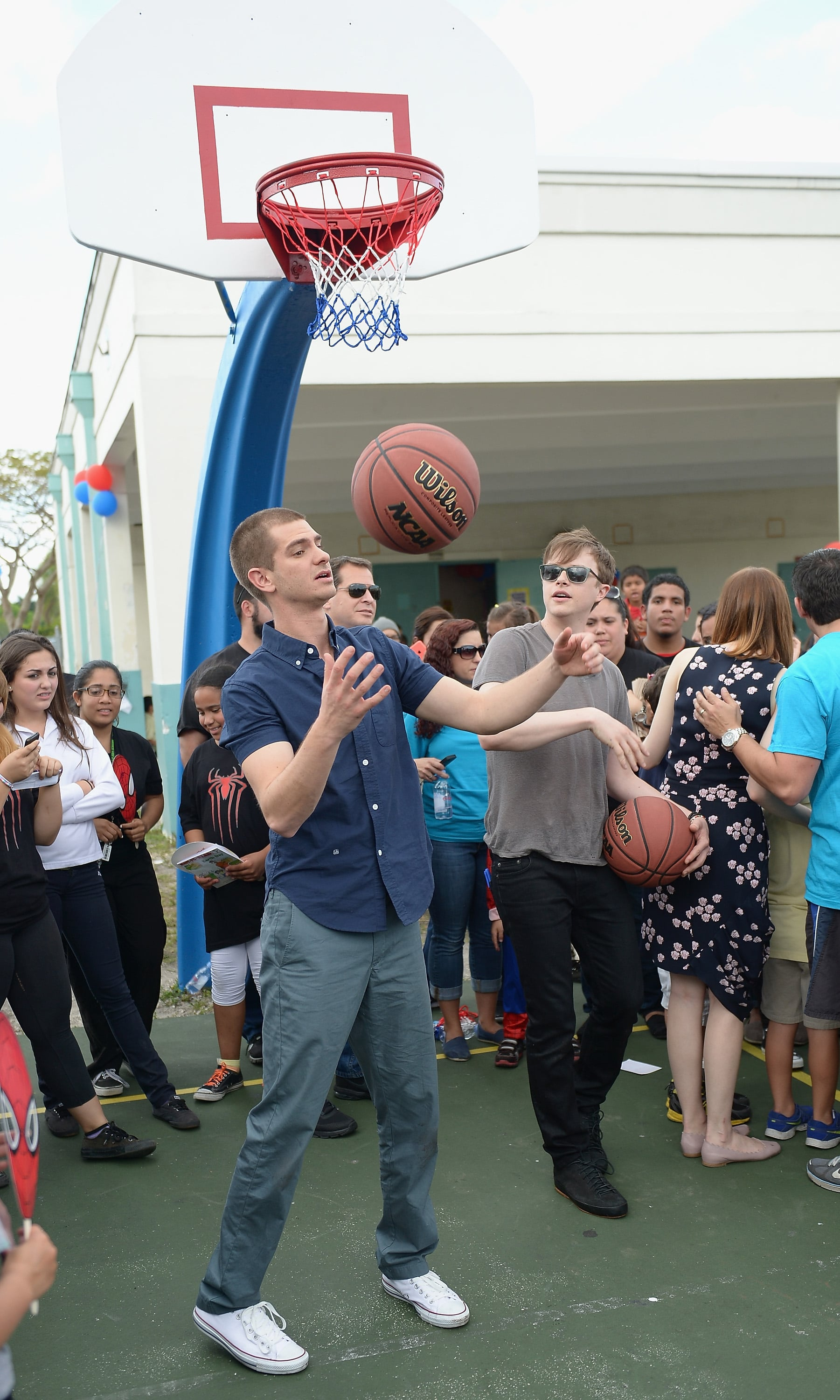 Andrew showed off his basketball skills while Dane watched.
