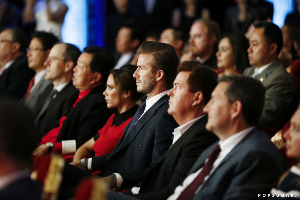 David Beckham put his hand on Victoria Beckham's lap while they watched the Peking Opera. Source: Tungstar/Splash News Online