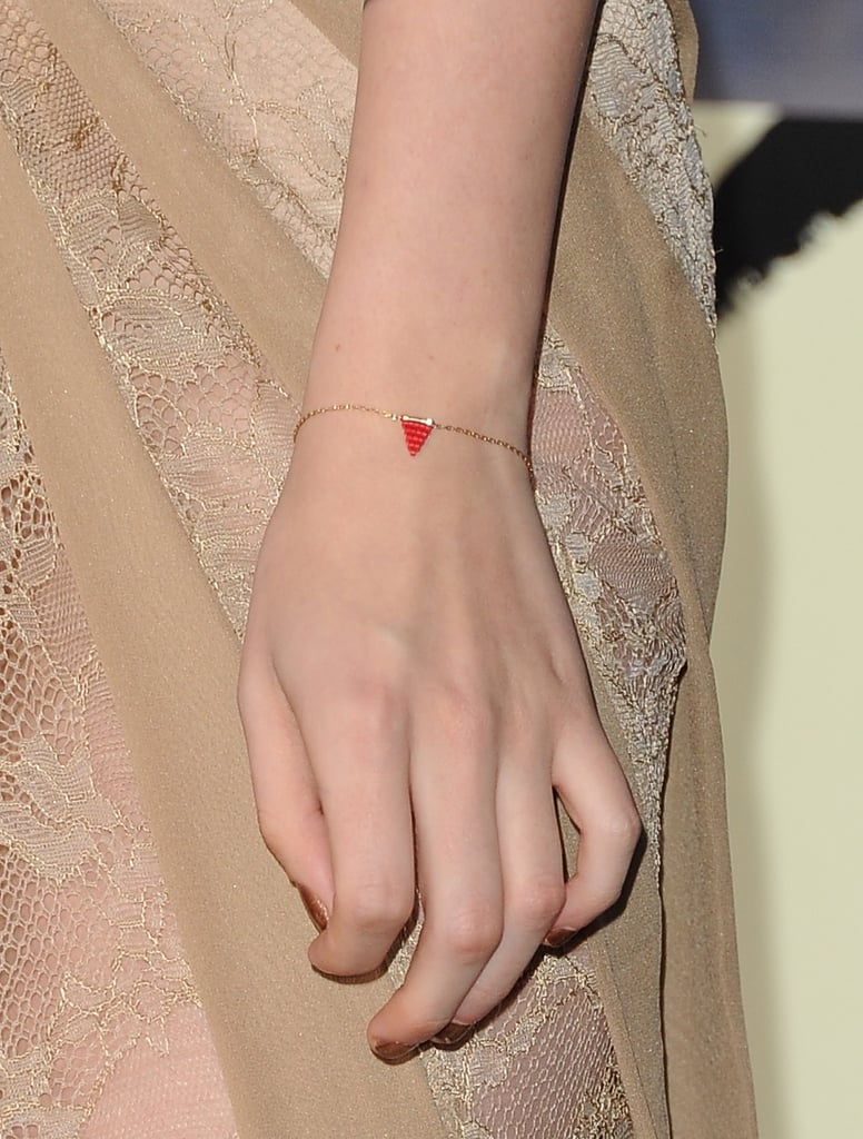 Her simple red charm bracelet was a subtle accenting choice.