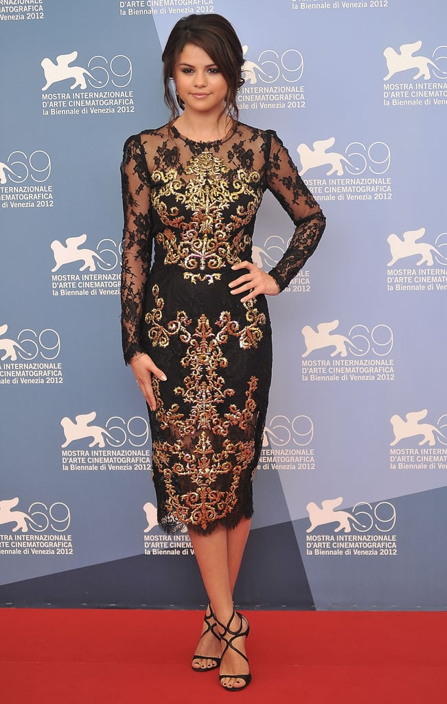 For the Venice Film Festival Spring Breakers photocall, Selena Gomez sported an embellished lace and gold brocade dress from Dolce & Gabbana's Fall 2012 collection.