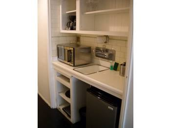 Check this kitchen out closely. At first glance, it may not seem that bad, but upon further examination, you'll realize that it's a mini-fridge, half sink, and microwave. There's no stove.