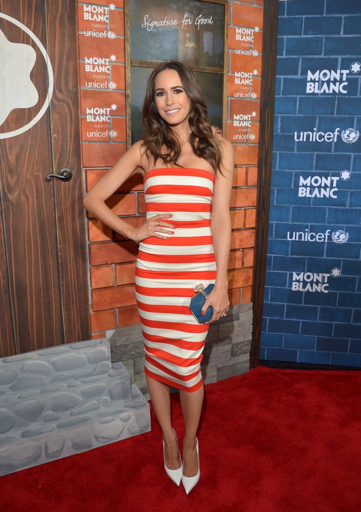 Louise Roe looked ready for warmer weather in an orange-and-white-striped fitted dress with white pointy pumps at the Montblanc and UNICEF pre-Oscars brunch.