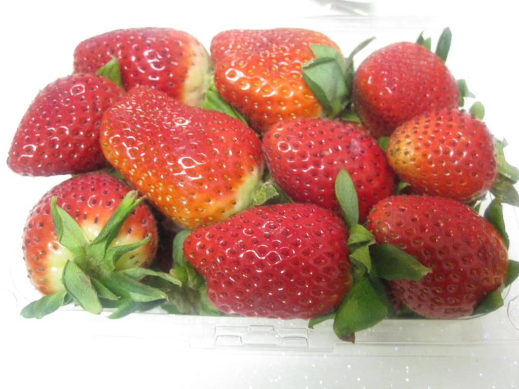 Start with a basket of bright red strawberries. Select berries that aren't overly ripe. Berries with plenty of stem are ideal.