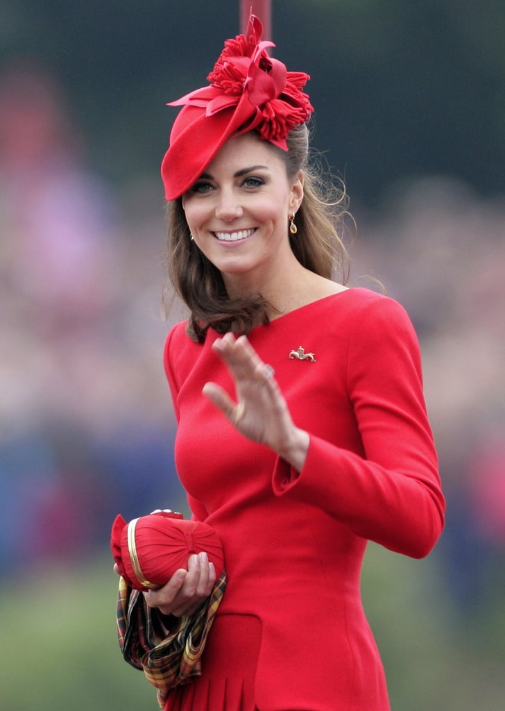 Kate carried a coordinating red clutch.