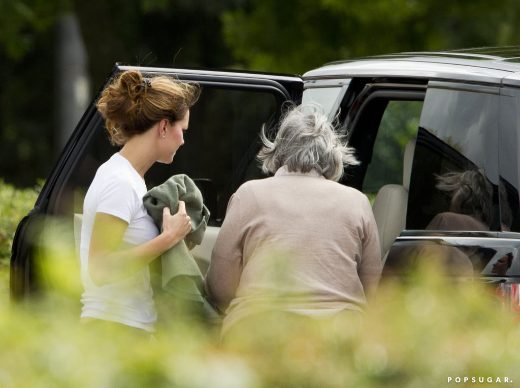 Kate Middleton and a nanny checked on Prince George in the backseat of the car.