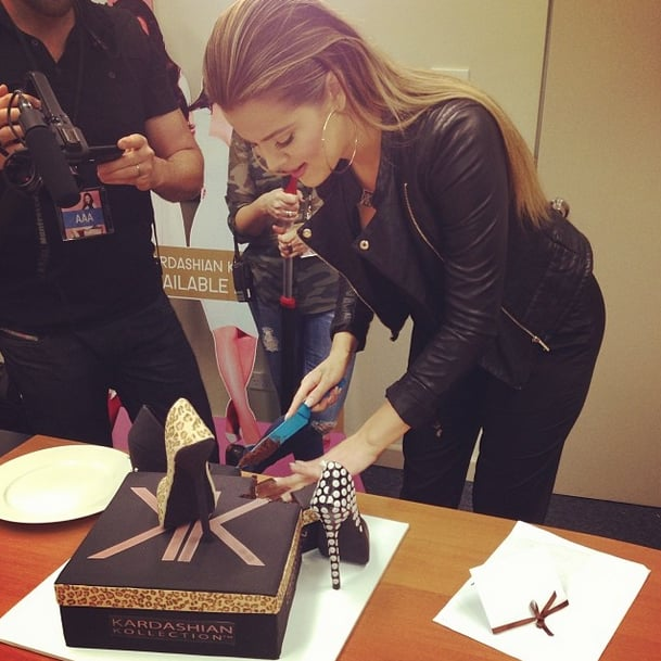 It's only fitting that Khloé Kardashian would cut into a shoe cake.  Source: Instagram user khloekardashian