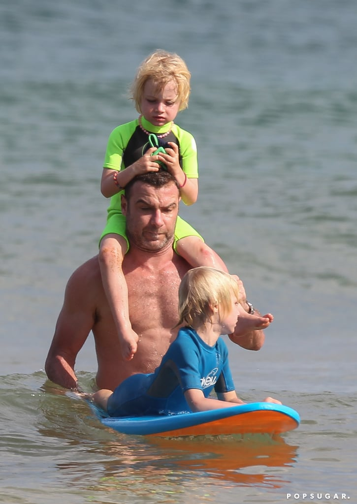 Liev Schreiber played in the water with his two children.