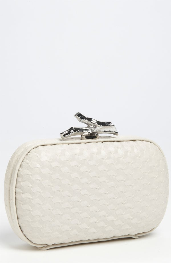 A bridal accessory with a dose of on-trend exotic texture that's still subtle enough to pair with your laciest frocks.  Diane von Furstenberg Lytton Small Embossed Clutch ($350)
