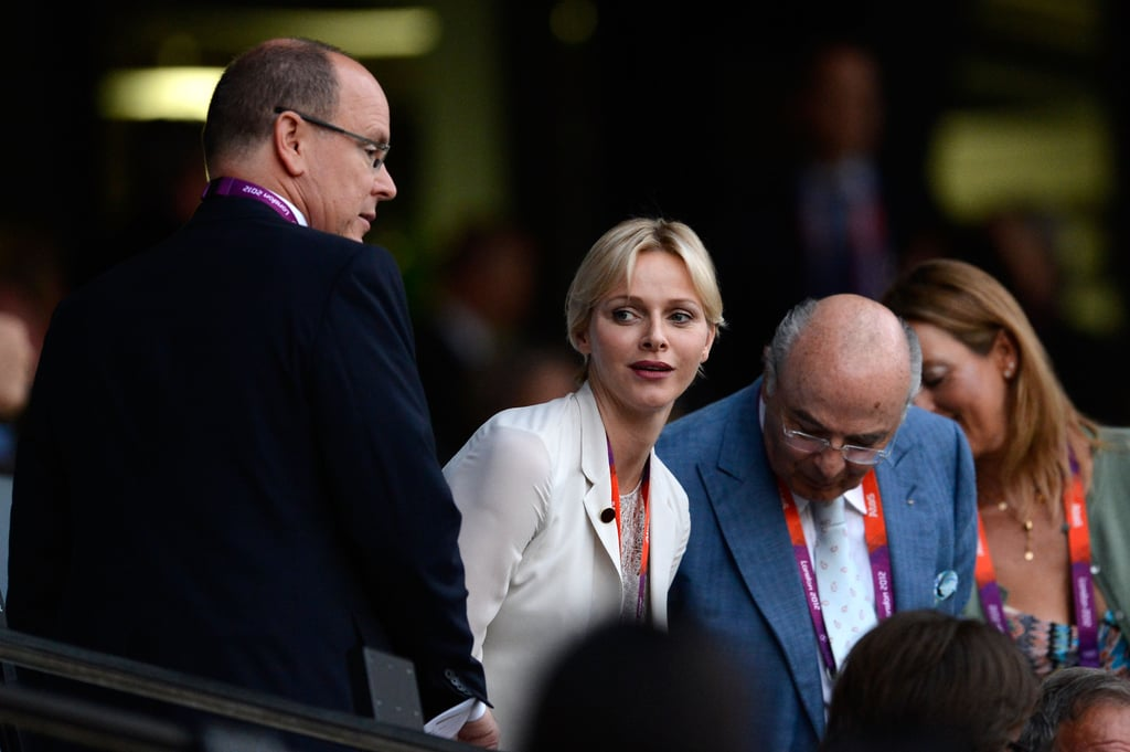 Prince Albert and Princess of Charlene of Monaco get seated at the opening ceremony.