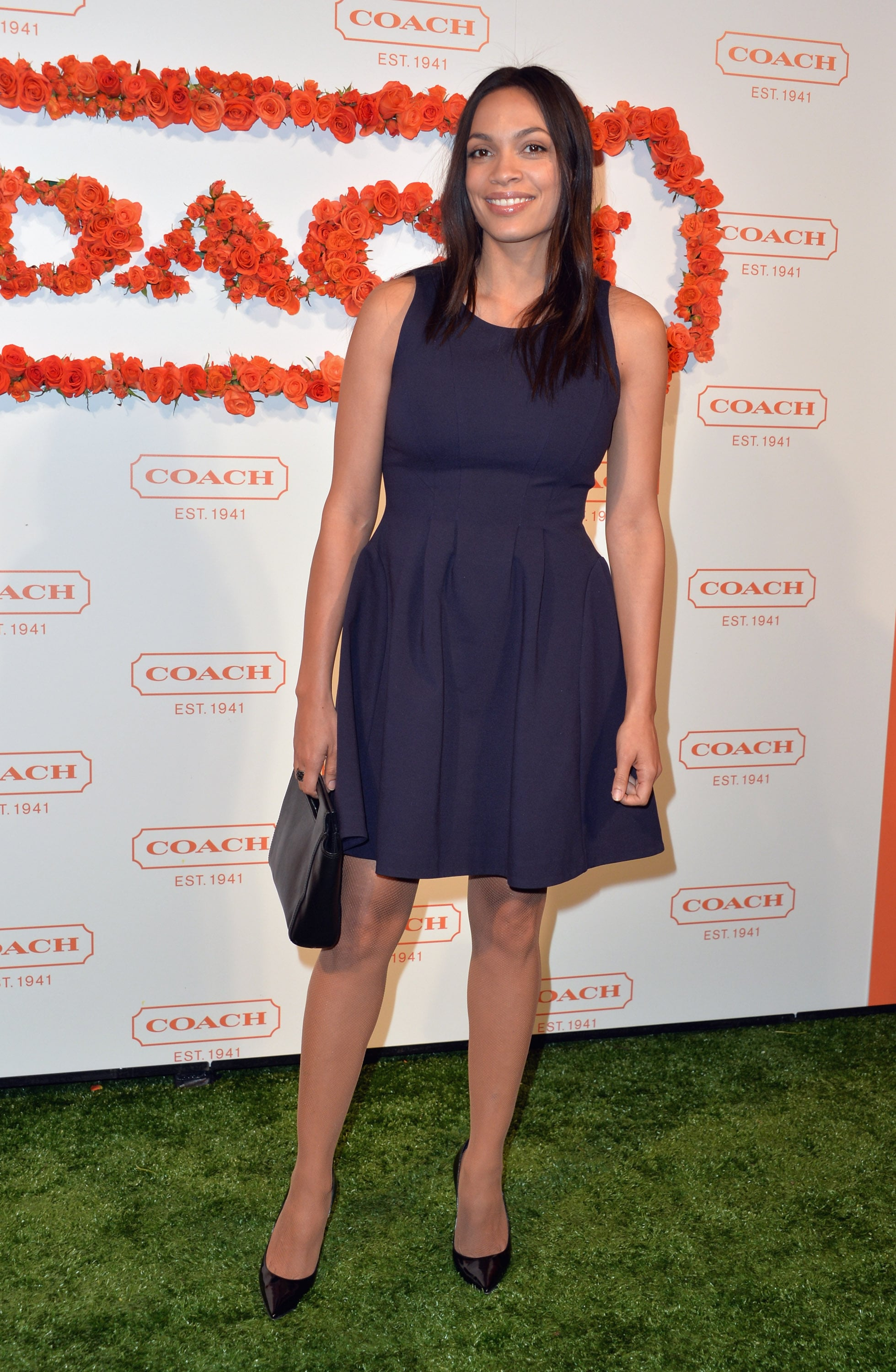 Rosario Dawson partnered sleek black accents with a navy blue fit-and-flare dress.