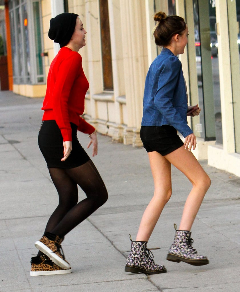 Miley Cyrus and her sister ran into a pet store.