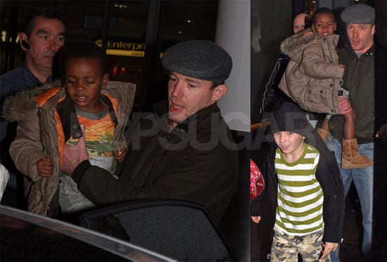 Photos of Guy Ritchie, Rocco Ritchie, and David Banda at London Gatwick Airport