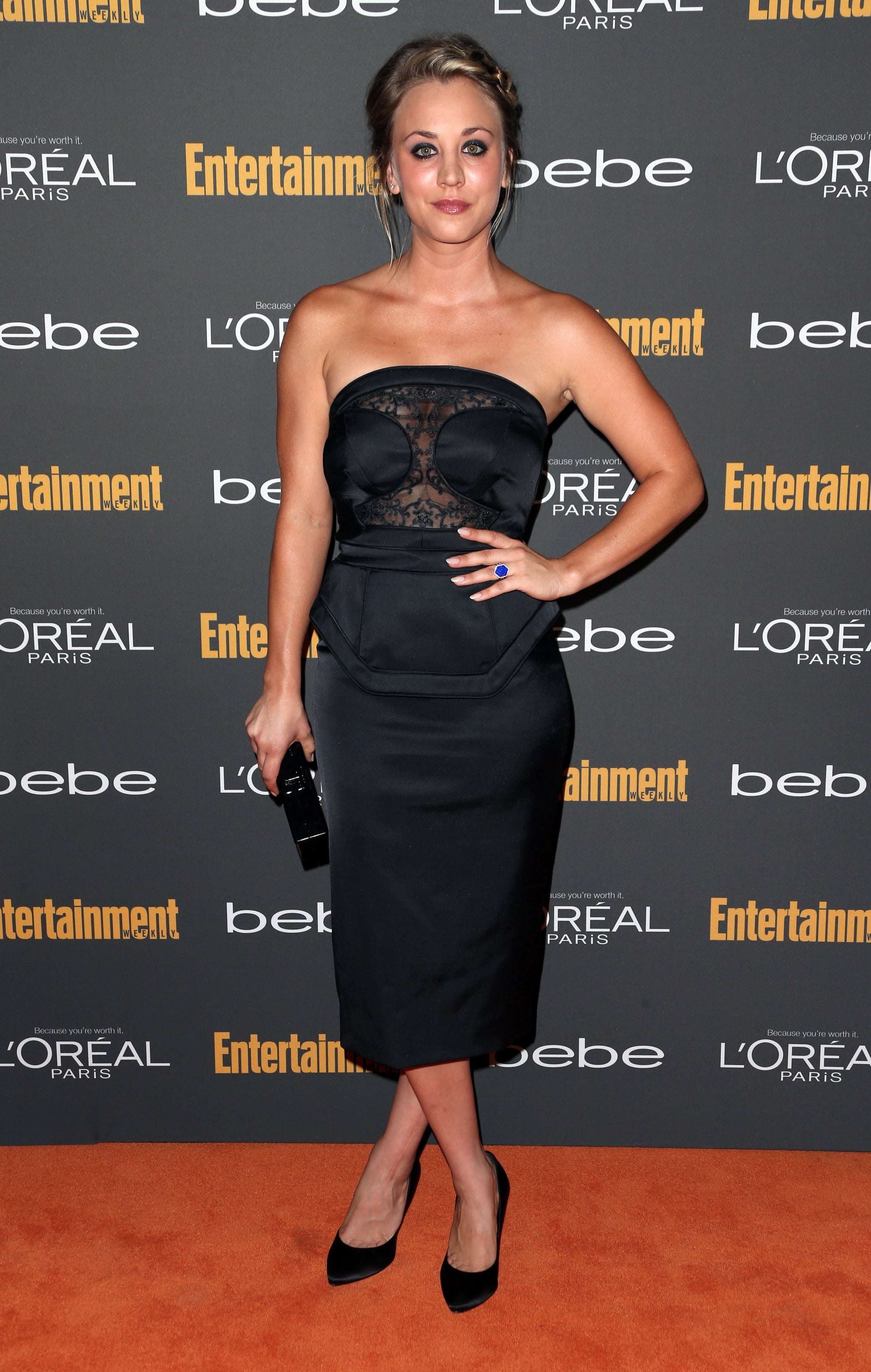 Kaley Cuoco was subtly sexy in a black strapless Pamella Roland dress with a sheer lace bodice, Pedro Garcia satin pumps, and an Edie Parker clutch at the Entertainment Weekly pre-Emmys party in LA.