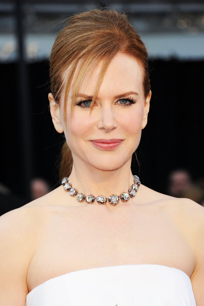 Nicole wore her hair pulled back into a sleek ponytail at the 2011 Oscars. Her piecey fringe added a striking element to the look.