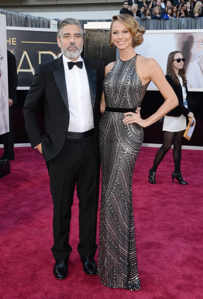 George Clooney hit the red carpet with Armani-clad Stacy Keibler by his side.